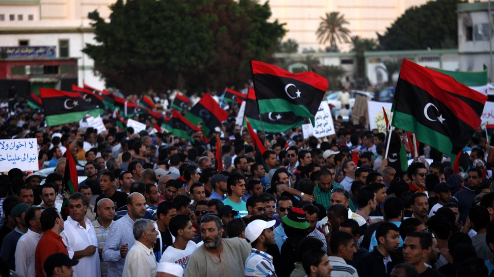 Libyans march against Ansar al-Shariah Brigades and other Islamic militias, in Benghazi, Libya, Friday, Sept. 21, 2012. (AP / Mohammad Hannon)