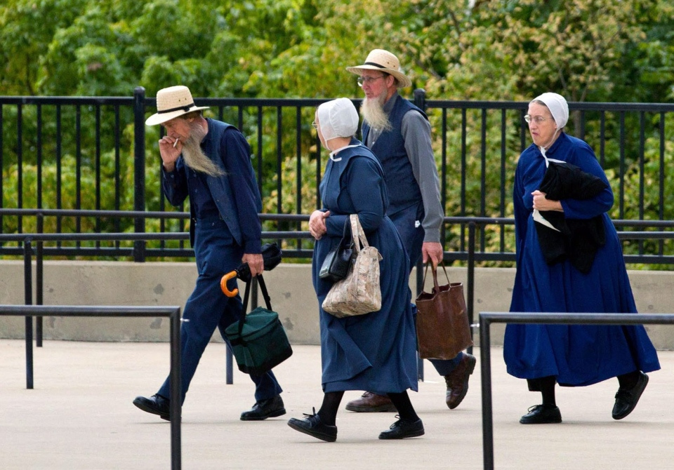 Members of the Amish community enter the U.S. Federal Courthouse in Cleveland, Ohio on Wednesday, Sept. 19, 2012.  (AP / Scott R. Galvin)