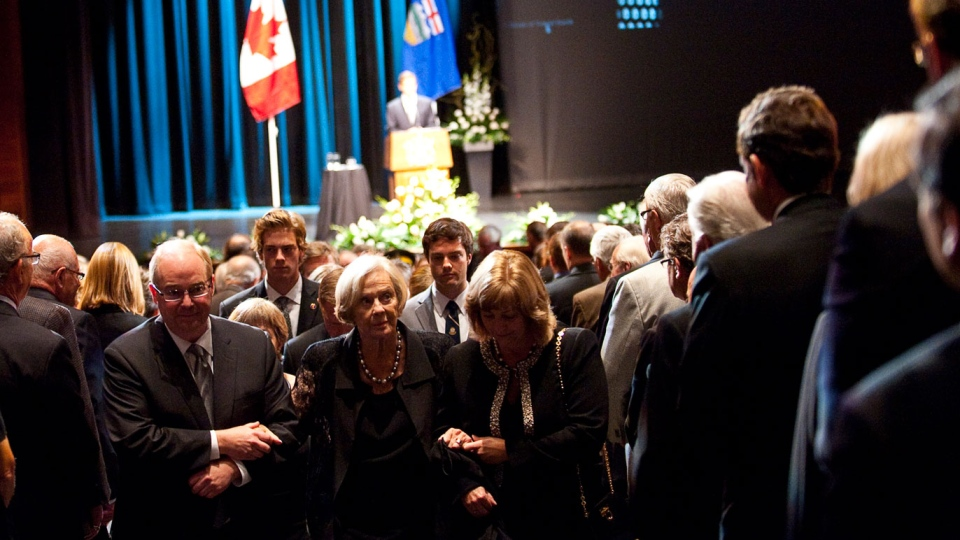 Jeanne Lougheed, centre, is helped by family members as she leaves the state memorial service for her husband and former Alberta premier Peter Lougheed in Calgary, Alta., Friday, Sept. 21, 2012. (Jeff McIntosh/THE CANADIAN PRESS)