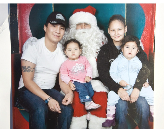 Christopher Pauchay, left to right, Santana Pauchay, Tracey Jimmy and Kaydance Paunchay are seen in this picture taken in December 2007 with Santa Claus.