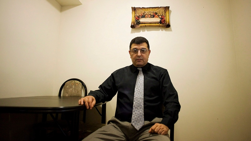 Nader Fawzy sits for a picture in his home in Toronto on September 20, 2012. Two Canadian human-rights activists say they fear for their lives after being wrongly linked to an anti-Muslim film that has sparked riots and protests around the world. (THE CANADIAN PRESS/Aaron Vincent Elkaim)
