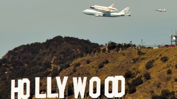 Space Shuttle Endeavour atop a modified 747 flies over the Hollywood sign on Sept. 21, 2012.