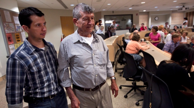 Dos Erres massacre survivor Oscar Alfredo Ramirez Castaneda, left, and his father on May 30, 2012.