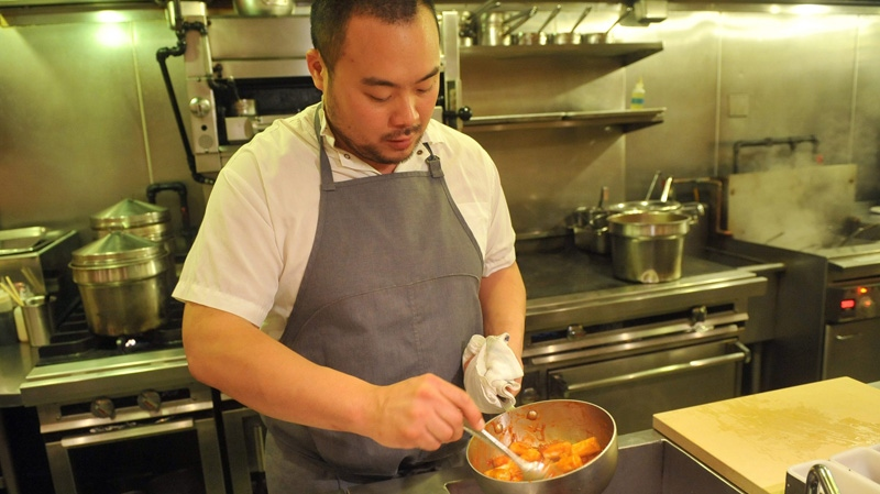Chef David Chang prepares roasted rice cakes in this Nov. 10, 2011 file photo.
