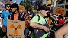 Protesters associated with the Occupy Wall Street movement march in protest of the natural gas drill