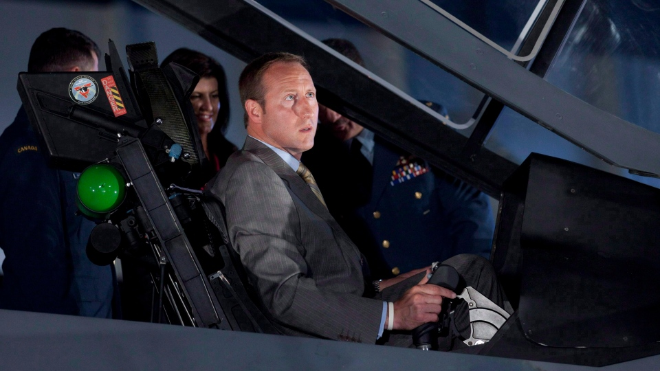 Minister of National Defence and Minister for the Atlantic Gateway Peter MacKay checks out the cockpit of the F-35 Joint Strike Fighter following an announcement in Ottawa, Friday, July 16, 2010. (Adrian Wyld / THE CANADIAN PRESS)