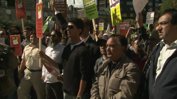 Protesters are shown demonstrating against an anti-Muslim film outside the U.S. embassy in Toronto