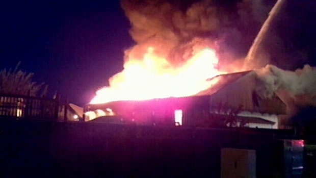 Flames tear through the Morinville Baptist Church overnight. The building will need to be torn down and completely rebuilt. PHOTO: Al Brettnell.
