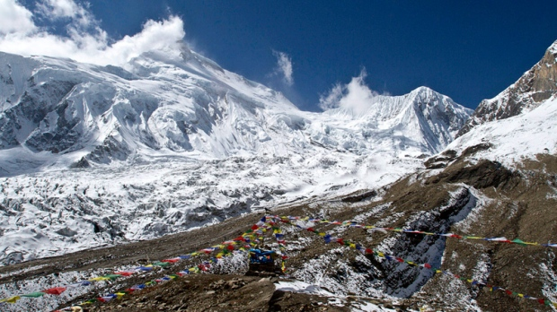 Prayer flags fly at the Manaslu base camp in Nepal on Oct. 18, 2011.