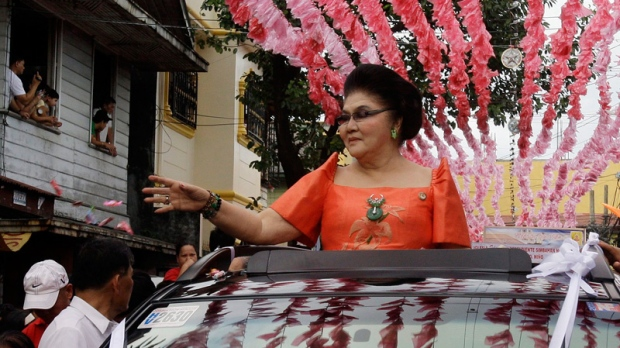 Former first lady Imelda Marcos in a parade in suburban Manila, Philippines on Jan. 14, 2012.