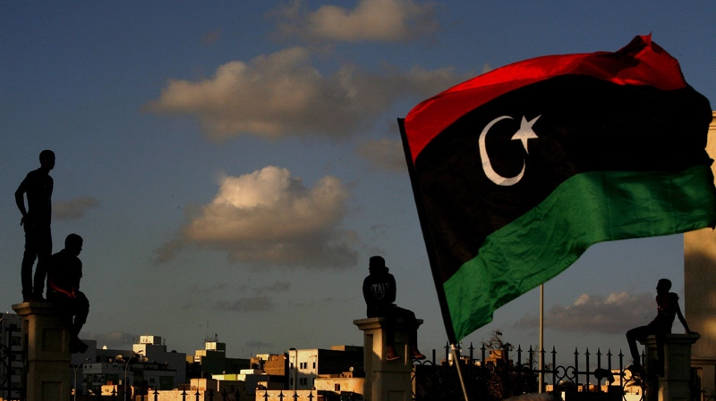 Libyans watch the protest against Ansar al-Shariah Brigades and other Islamic militias, in Benghazi, Libya, Friday, Sept. 21, 2012. (AP Photo/Mohammad Hannon)