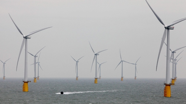 A small boat passes through the windmills of the Thanet Offshore Wind Farm off the coast of Ramsgate in Kent, England Thursday Sept. 23, 2010 as it is officially opened becoming the world's largest site of its type. (AP Photo/Gareth Fuller/PA )