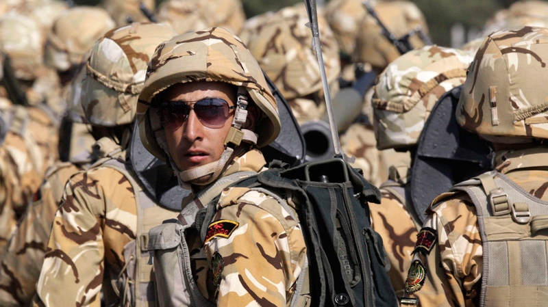 An Iranian army soldier participates in a military parade commemorating the start of the Iraq-Iran war 32 years ago, in front of the mausoleum of the late revolutionary founder Ayatollah Khomeini, just outside Tehran, Iran, Friday, Sept. 21, 2012. (AP Photo/Vahid Salemi)