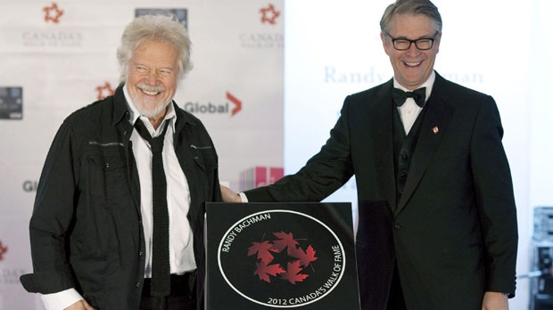 Musician Randy Bachman (left) stands with Bruce Rothney