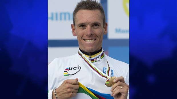 Philippe Gilbert of Belgium shows his gold medal in Valkenburg, Netherlands on Sept. 23, 2012.