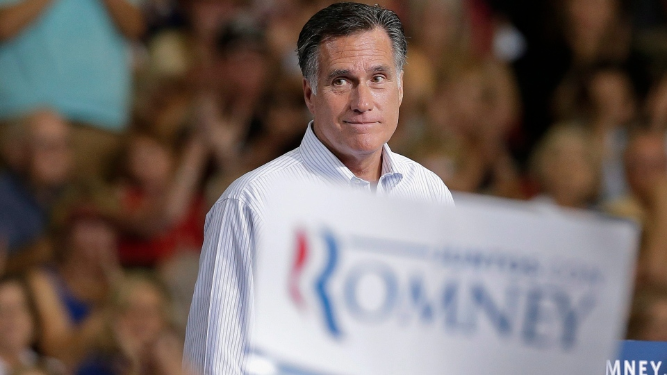 Republican presidential candidate and former Massachusetts Gov. Mitt Romney pauses as supporters cheer to remarks during a rally in Las Vegas on Friday, Sept. 21, 2012. (AP /Julie Jacobson)