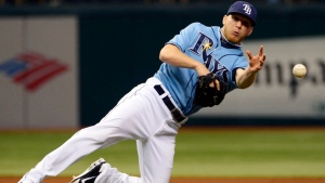 Tampa Bay Rays pitcher J.P. Howell throws out Toronto Blue Jays' Colby Rasmus at first base after fielding his ground ball during the seventh inning of a baseball game in St. Petersburg, Fla., Sunday, Sept. 23, 2012. (AP / Phelan M. Ebenhack)