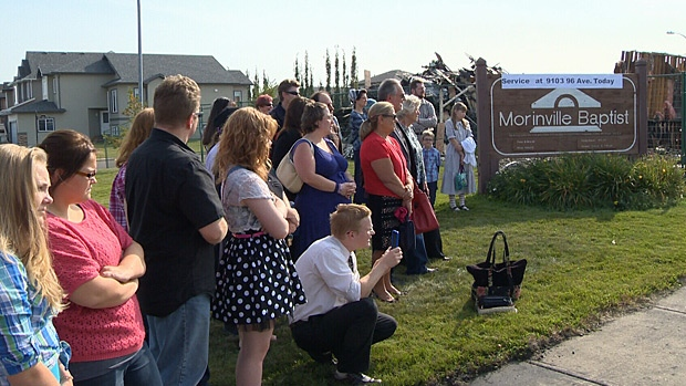 Morinville Baptist Church members say goodbye to their church building, which was destroyed by fire on Saturday.