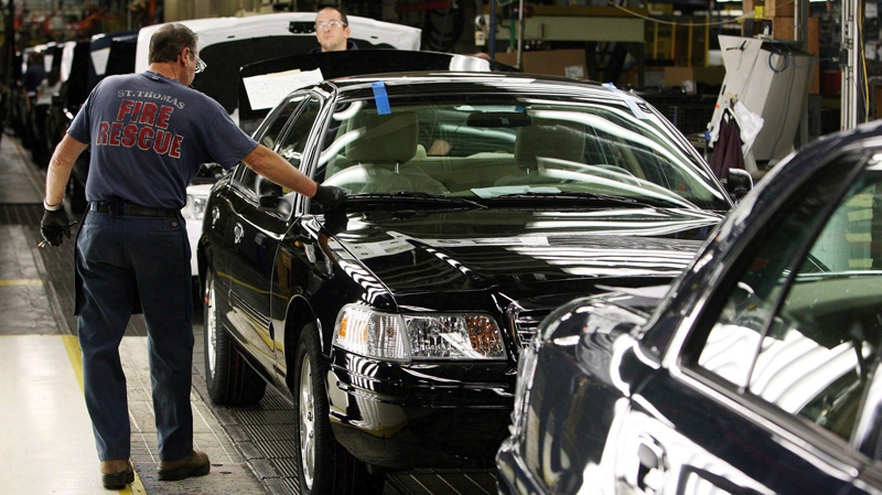 Factory employees work on Ford Crown Victoria vehicles on Thursday, September 8, 2011 at the Ford Assembly Plant in St. Thomas, Ont. (THE CANADIAN PRESS/Dave Chidley)