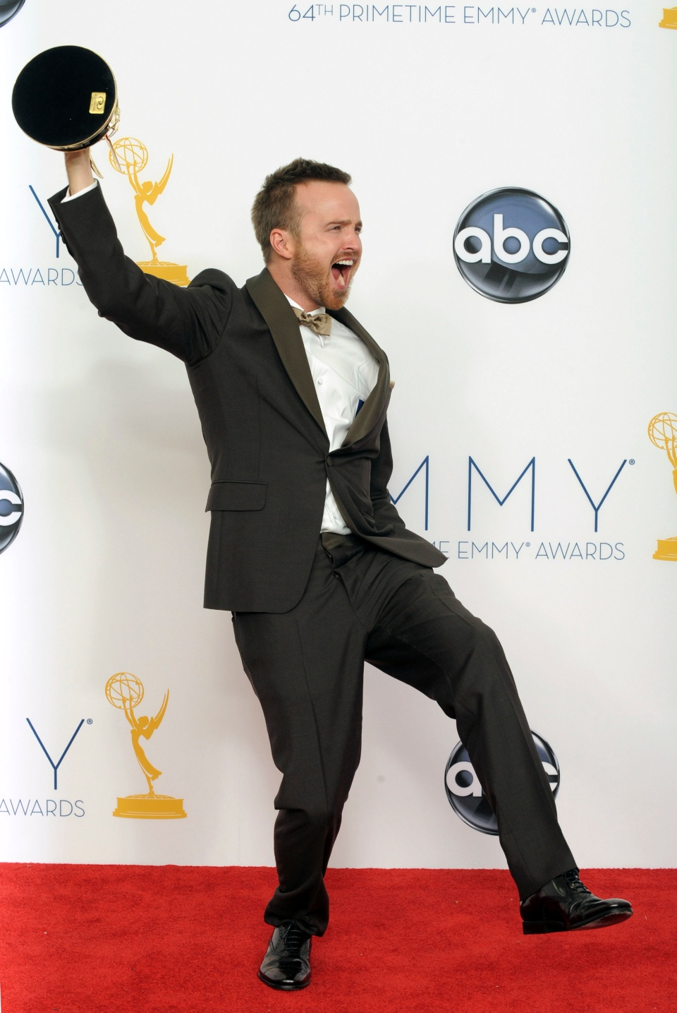 Actor Aaron Paul, winner of Outstanding Supporting Actor In A Drama Series for 'Breaking Bad,' poses backstage at the 64th Primetime Emmy Awards at the Nokia Theatre on Sunday, Sept. 23, 2012, in Los Angeles. (Jordan Strauss / Invision)