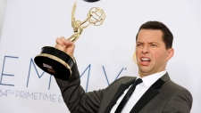 Actor Jon Cryer, winner of Outstanding Lead Actor in a Comedy Series, poses backstage at the 64th Pr