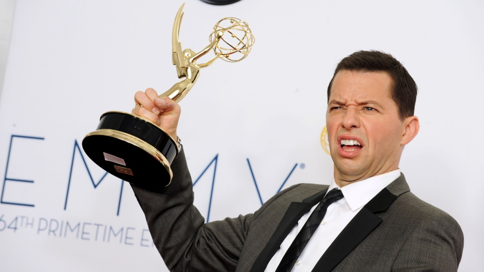 Actor Jon Cryer, winner of Outstanding Lead Actor in a Comedy Series, poses backstage at the 64th Primetime Emmy Awards at the Nokia Theatre on Sunday, Sept. 23, 2012, in Los Angeles. (Jordan Strauss / Invision)