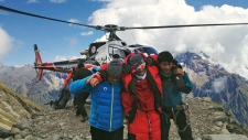 An injured victim, centre, is rescued at the base camp of Mount Manaslu in northern Nepal