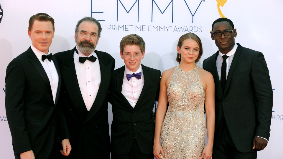 The cast of 'Homeland,' from left, Diego Klattenhoff, Mandy Patinkin, Jackson Pace, Morgan Saylor and David Harewood, arrived at the 64th Primetime Emmy Awards at the Nokia Theatre on Sunday, Sept. 23, 2012, in Los Angeles. (Photo by Jordan Strauss/Invision/AP).