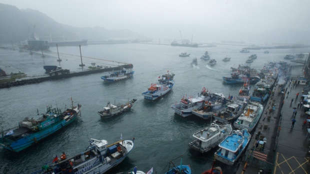 Fishing boats set out from Suao harbour, Taiwan to the East China Sea on Sept. 24, 2012.