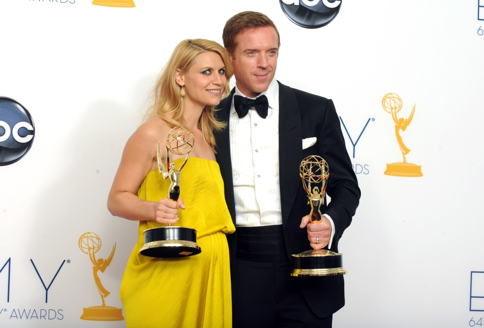 Actress Claire Danes, winner of the Emmy for Outstanding Lead Actress In A Drama Series for 'Homeland' and actor Damian Lewis, winner Outstanding Lead Actor In A Drama Series for 'Homeland' pose togther backstage at the 64th Primetime Emmy Awards at the Nokia Theatre on Sunday, Sept. 23, 2012, in Los Angeles. (Jordan Strauss / Invision)