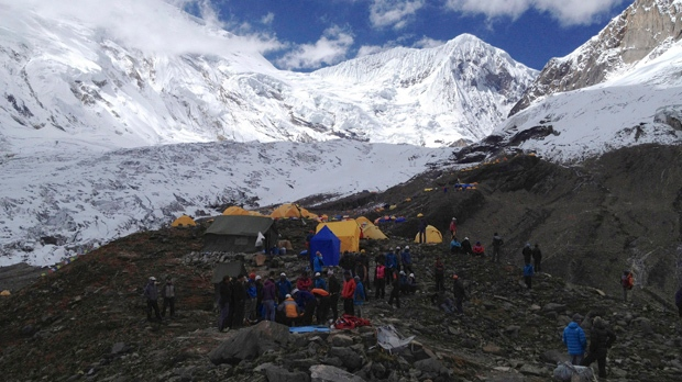 Rescuers attend to injured victims, unseen, in an avalanche at the base camp of Mount Manaslu in northern Nepal on Sunday, Sept. 23, 2012. (AP /Simrik Air)