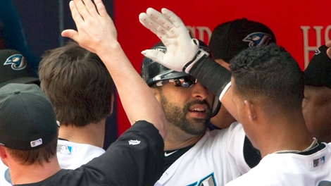Toronto Blue Jays' Jose Bautista is congratulated in the dugout after hitting his 50th home run of the season during the first inning of a Major League baseball game against the Seattle Mariners in Toronto, Thursday Sept. 23, 2010. (Frank Gunn / THE CANADIAN PRESS)