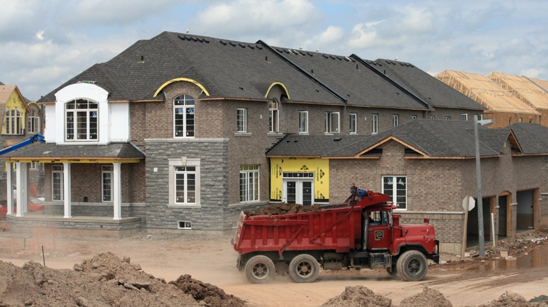 A dump truck at a new housing development in Oakville, Ont. on Aug.26, 2012.