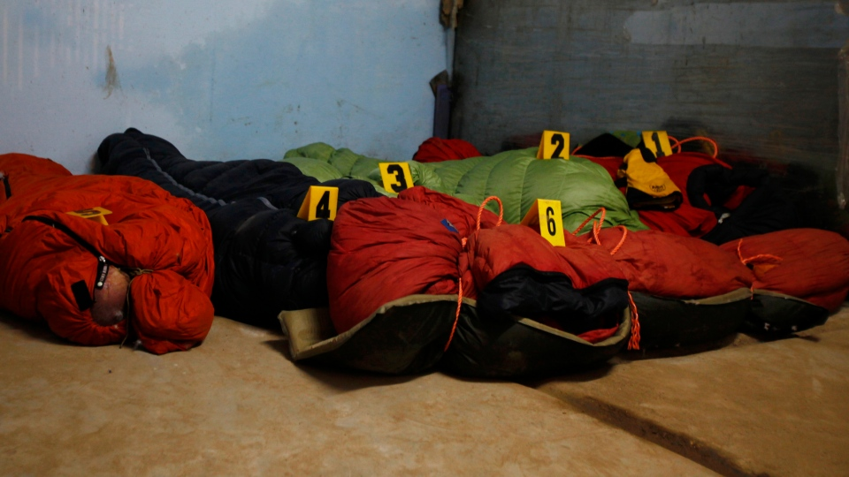 Bodies of climbers killed in an avalanche at Mount Manaslu lie covered with numbers at the Tribhuvan University Teaching hospital in Katmandu, Nepal, Monday, Sept. 24, 2012. (AP / Niranjan Shrestha)