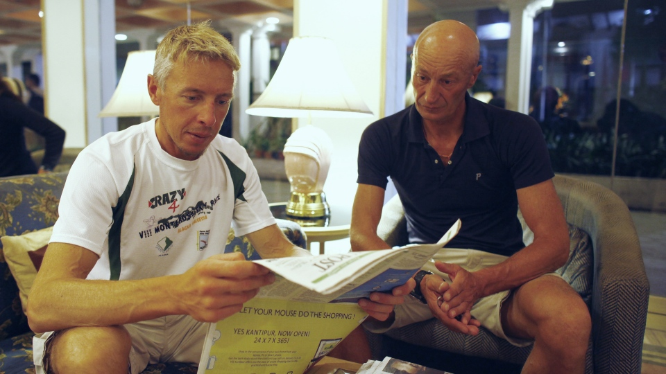 Italians, Silvio Mondinelli, right and Christian Gobbi, survivors of Sunday's avalanche at Mount Manaslu in northern Nepal, read a newspaper at a hotel in Katmandu, Nepal, after being rescued from the mountains, Monday, Sept. 24, 2012.  (AP / Niranjan Shrestha)