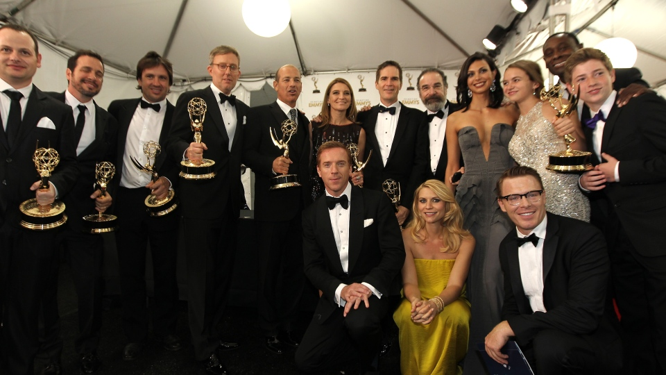The cast of 'Homeland,' winner, Outstanding Drama Series pose backstage at the 64th Primetime Emmy Awards at the Nokia Theatre on Sunday, Sept. 23, 2012, in Los Angeles. (Matt Sayles / Invision)
