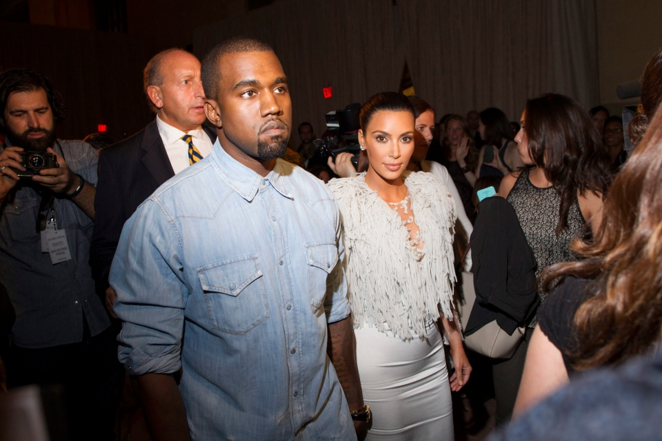 Kanye West, left, and Kim Kardashian attended the FIJI Water-sponsored Marchesa Spring 2013 Fashion Show at Vanderbilt Hall in New York on Wednesday, Sept. 12, 2012. (Photo by Victoria Will / Invision for FIJI Water)