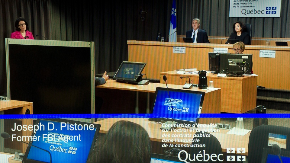 A television monitor show former FBI agent Joe Pstone, also known as Donnie Brasko, testifying behind a screen at the Charbonneau inquiry looking into corruption in the Quebec construction industry Monday, Sept. 24, 2012 in Montreal. .(Ryan Remiorz / THE CANADIAN PRESS)
