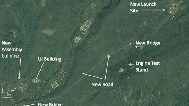 A structure which an analyst says is an unfinished rocket launch site, top right, and other major new facilities at the Tonghae launch complex are seen near the village of Musudan-ri on the northeast coast of North Korea, Aug. 29, 2012. (DigitalGlobe)