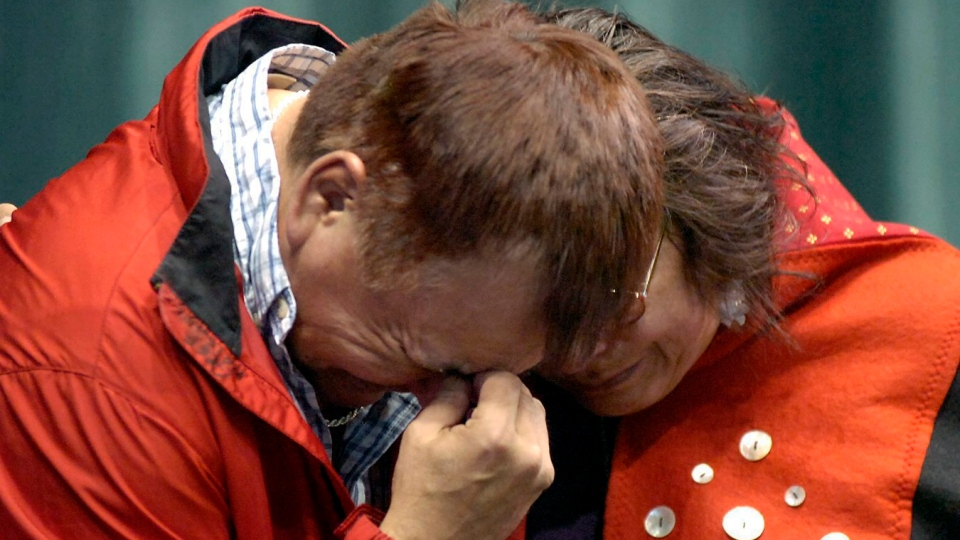 Greg Wright and Gladys Radek, the aunt of a woman missing on Highway 16, comfort each other at the opening of the Highway of Tears in Prince George, B.C., Thursday March 30, 2006. (Dave Milne / PRINCE GEORGE CITIZEN)
