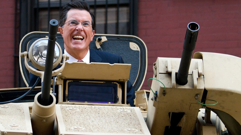 Stephen Colbert rides an Army ASV while taping an episode of the Colbert Report on West 54th Street in New York, Wednesday, Sept. 8, 2010. (AP / Charles Sykes)