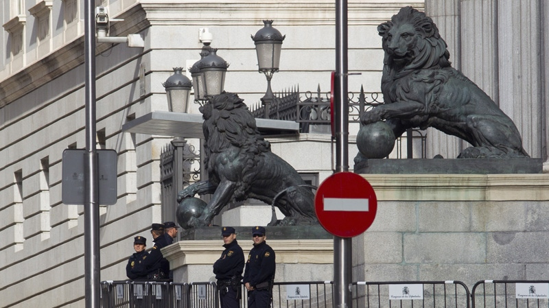 Police guard the entrance of the Spanish parliament in Madrid, Tuesday Sept. 25, 2012. (AP Photo/Paul White)