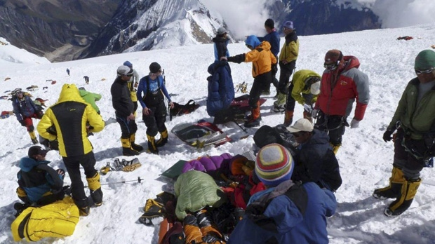 Rescuers and climbers prepare survivors for evacuation from the debris field of an avalanche on Mount Manaslu in northern Nepal on Sunday, Sept. 23, 2012. (AP /Garrett Madison, Alpine Ascents International)