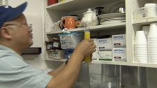 Pharmacist Alex Tam prepares methadone in Vancouver's Downtown Eastside. Sept. 24, 2010. (CTV)