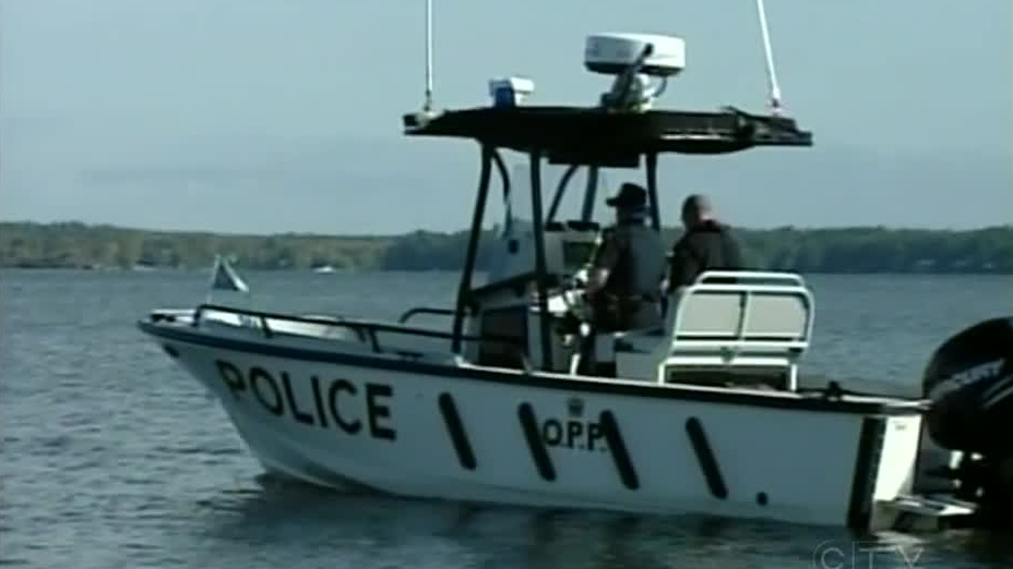An OPP search boat is seen on Sparrow Lake near Orillia, Ont. on Tuesday, Sept. 25, 2012.