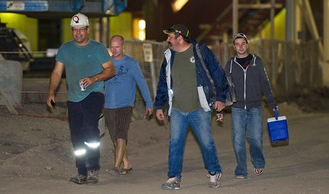 PotashCorp miners walk out of the Rocanville potash mine Tuesday night after being rescued from an underground fire on Tuesday, Sept. 25, 2012. (David Lipnowski / THE CANADIAN PRESS)