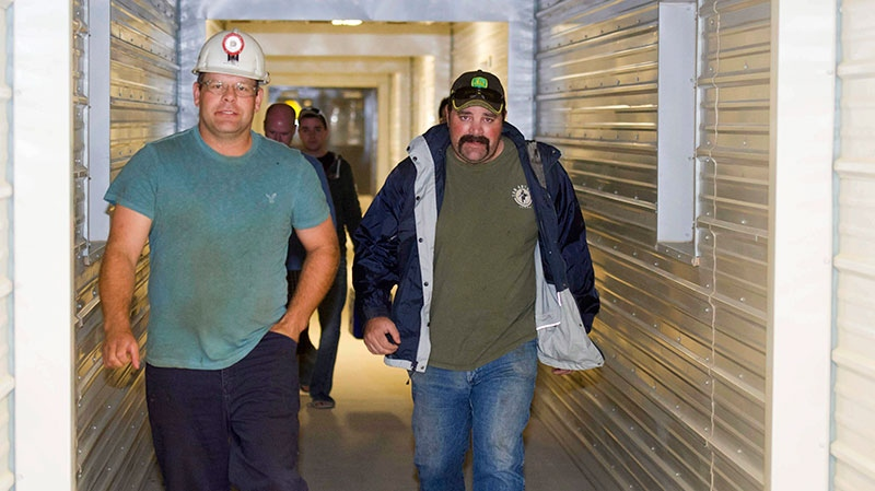 PotashCorp miners walk out of the Rocanville potash mine Tuesday night after being rescued from an underground fire on Tuesday, Sept. 25, 2012.  (David Lipnowski / THE CANADIAN PRESS