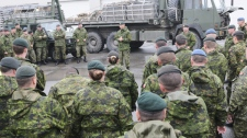 Lieutenant Colonel (LCol) Jim Goodman talks to military members after a convoy of military vehicles just embarked from the Joseph and Clara Smallwood ferry at Argentia, Newfoundland on Saturday Sept. 25, 2010. (DND-HO-WO Jerry Kean / THE CANADIAN PRESS)