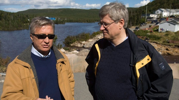 Prime Minister Stephen Harper and Premier Danny Williams, left, talk with reporters as they visit Trouty, Newfoundland and Labrador on Friday, Sept. 24, 2010. (Andrew Vaughan / THE CANADIAN PRESS)