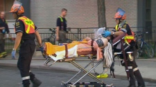 A victim of a highrise fire is taken from the scene on Friday, Sept. 24, 2010. Fourteen people were injured in the six-alarm blaze.